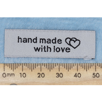 "Tag,white, black embroidered wording ""hand made with love "" with double heart symbol"