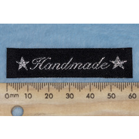 "Tag,black, silver embroidered wording ""Handmade "" with 2 star symbols"