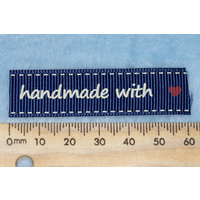 "Tag,blue with white print wording ""handmade with "" with red heart symbol"