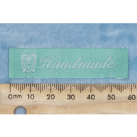 "Tag, mint with white embroidered  wording ""Handmade"" with Owl symbol"